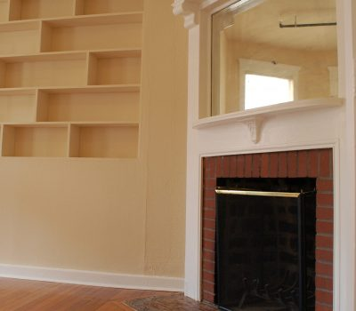 Room with Fireplace and Mirror Above and In Wall Shelf Space