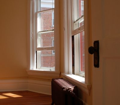 Windows in Living Room with Small Radiator