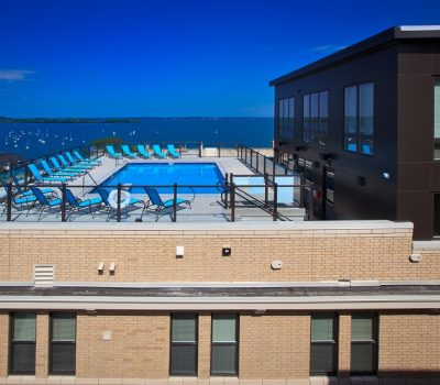 Rooftop Community Pool with Blue Lawn Chairs