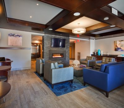 Clubhouse Couch Area with Modern Fireplace